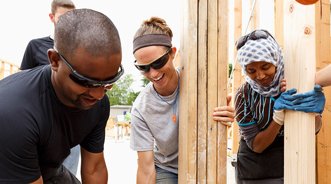 People building a house