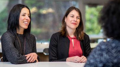 two female employees in a meeting